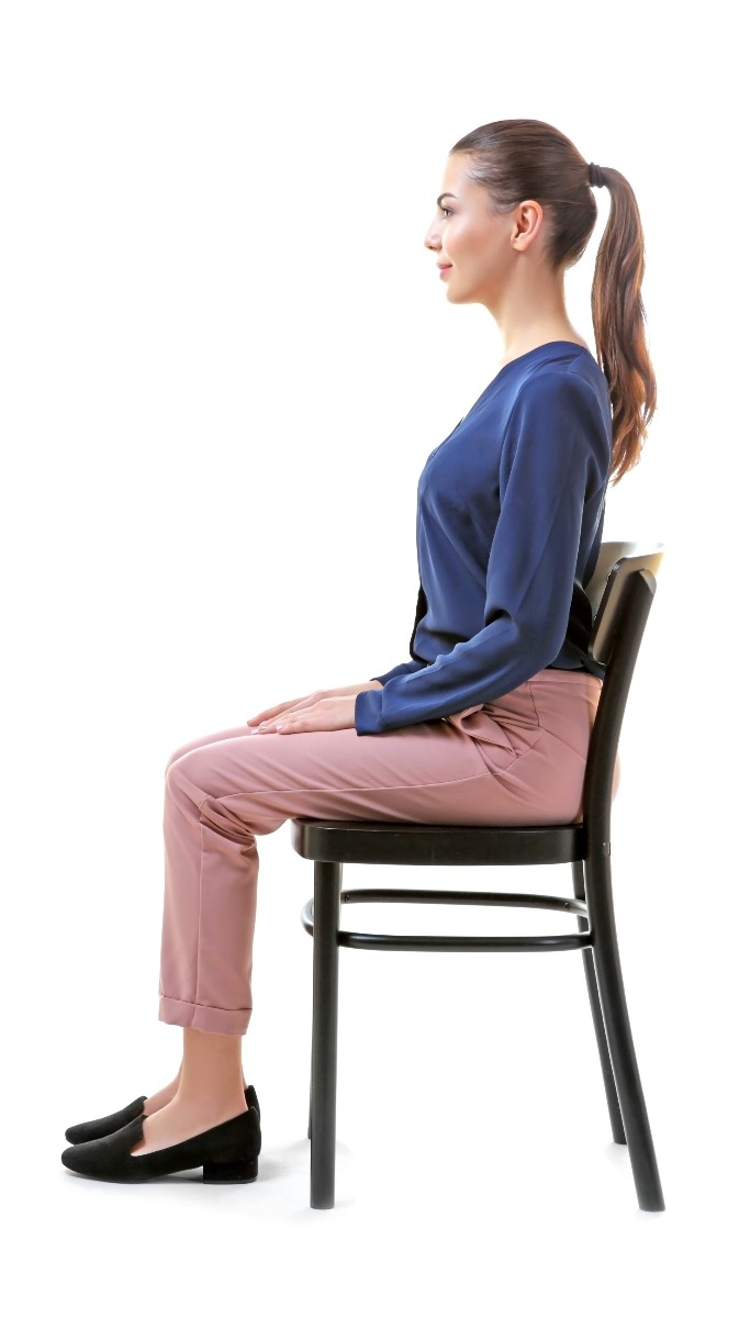 When sitting, remember to put your bum at the back of your chair; lengthen your spine and again, maintain that natural inward curve at your lower spine